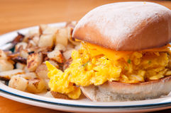 Egg and cheese on a toasted bap Royalty Free Stock Images
