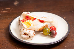 Egg, cheese and tomato wrap Stock Images