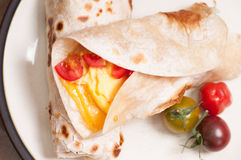 Egg, cheese and tomato wrap Stock Photography