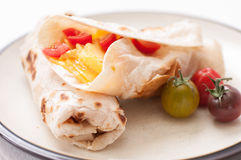 Egg, cheese and tomato wrap Royalty Free Stock Image