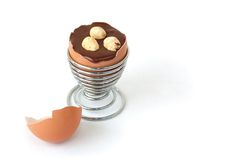 Egg with chocolate surprise and hazelnuts Stock Photos