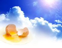 Egg with clouds. Egg broken with a sky and cloud background Royalty Free Stock Image