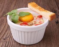 Egg cocotte Stock Images