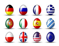 Egg collection from the world. Eastereggs with a international flag on a white background Stock Photo