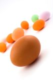 Egg with colored Easter eggs stock image