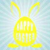 Egg con los oídos de conejo y las palabras Pascua feliz Fotos de archivo libres de regalías