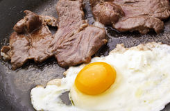 Egg cooked with meat Stock Image