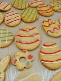 Egg cookies. Egg shaped Easter cookies and decorated Royalty Free Stock Image