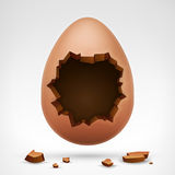 Egg with cracked shell and hollow in middle Royalty Free Stock Images