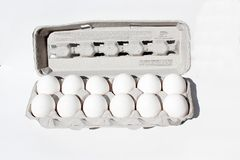 Egg crate isolated on white with a dozen eggs. Royalty Free Stock Photography