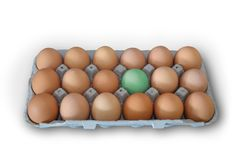 Egg in a crate standing out fom the crowd royalty free stock image