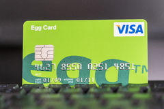 Egg credit card on a keyboard royalty free stock image