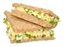 Egg And Cress Sandwiches. Fresh egg and cress sandwiches cut into triangles with crust removed and isolated on a white background Royalty Free Stock Photo