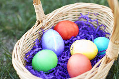 Egg with Cross among basket of colored Eggs. In a field on a Sunny Day Royalty Free Stock Photo