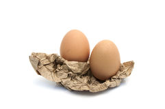 Egg in crumpled wrapping gray paper Royalty Free Stock Images