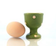 Egg Cup. And egg on white bacground Royalty Free Stock Photography