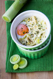 Egg in cup with leek Royalty Free Stock Photography