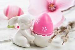 Egg cup with a pink easter egg. An egg cup with a pink easter egg stock image