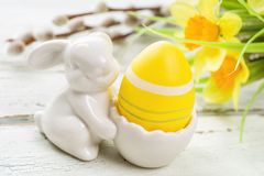Egg cup with a yellow easter egg. An egg cup with a yellow easter egg stock photography