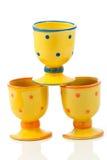 Egg-cups cerâmicos pontilhados amarelo   Fotografia de Stock