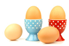 Egg cups with eggs Stock Photos