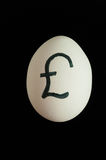 Egg with currency sign of GBP on it Stock Photo