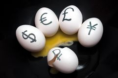 Egg with currency signs Stock Photo