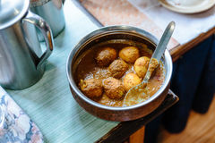 Egg curry in stainless steel bowl is a lunch of hotel in winter at Lachen. North Sikkim, India Royalty Free Stock Photo
