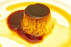 Egg custard with caramel sauce Stock Images