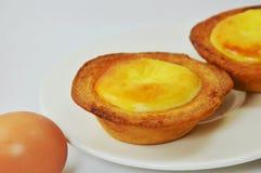 Egg custard tart on dish Stock Photos