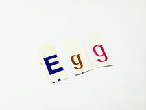Egg - Cutout Words Collage Of Mixed Magazine Letters with White Background. Caption composed with letters torn from magazines with White Background Royalty Free Stock Photo