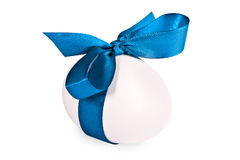 Egg decorated with a dark blue tape Royalty Free Stock Photo