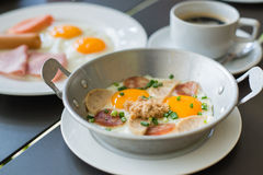 Egg dish Breakfast served with fried egg, ham, orange juice, del Stock Photo