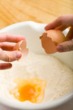 Egg in dough mixture Royalty Free Stock Photos