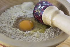 Egg dropped in flour Stock Photography