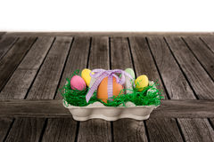 Egg in a easter nest with small eggs on a table. Royalty Free Stock Photos