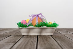 Egg in a easter nest with small eggs on a table. Royalty Free Stock Images
