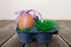 Egg in a easter nest on a table. Royalty Free Stock Photo