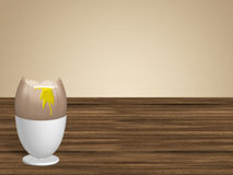 Egg in egg cup. Broken egg in egg cup om table Royalty Free Stock Photos