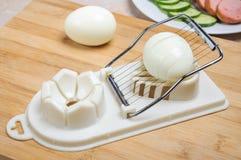 The egg on egg slicer Royalty Free Stock Photography