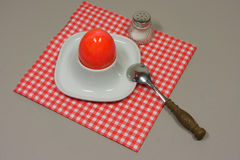 Egg in eggcup. On red white checkered napkin Stock Photo