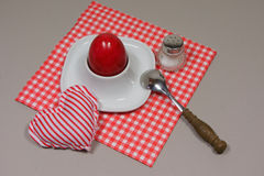 Egg in eggcup. On red white checkered napkin Royalty Free Stock Photo