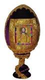 Egg em um suporte com o ícone do senhor isolado em um fundo branco Fotos de Stock Royalty Free