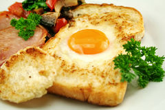 Egg Embedded In Toast Stock Images