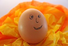 Egg with eyes nose and mouth Stock Images