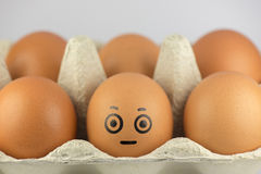Egg with a face Stock Photos