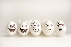 An egg with a face. Concept.the wall of eggs Stock Photography