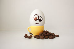Egg with a face. Funny and cute to a coffee mug Royalty Free Stock Photo