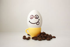 Egg with a face. Funny and cute to a coffee mug Royalty Free Stock Images