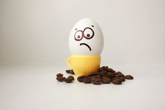 Egg with a face. Funny and cute to a coffee mug Stock Image